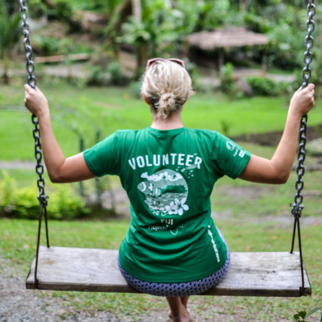 A Projects Abroad volunteer swinging in the Garden of Sleeping Giants, a bucket list destination in Fiji